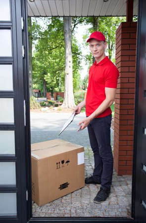 Delivery guy leaving a large package at doorstep photo