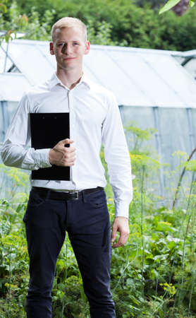 quality controller: Quality controller during his work in glasshouse Stock Photo
