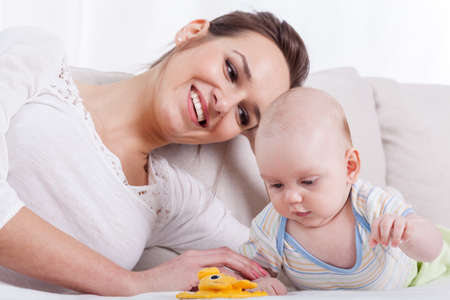 progeny: Horizontal view of happy mother and baby Stock Photo