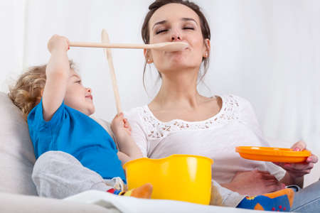 children at play: Cute preschooler and mum playing at kitchen