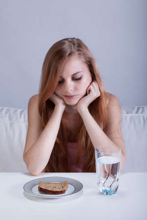 starvation: Young sad girl being on a starvation diet