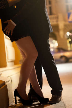 sensual nude: Vertical view of people embracing at night Stock Photo