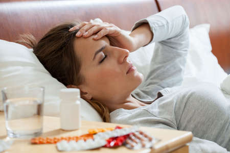 Horizontal view of woman suffering from flu Stock Photo