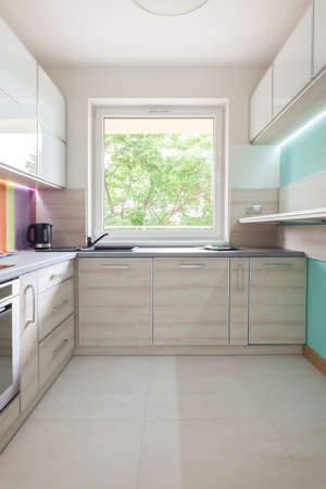 contemporary kitchen: Contemporary and illuminated kitchen with beige furniture  Stock Photo