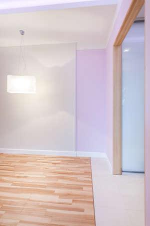 Big bright empty room with violet walls photo