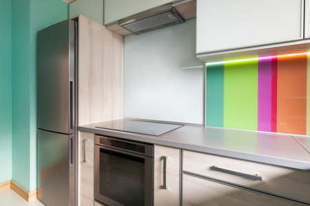 Colourfull modern kitchen with decorative wall photo
