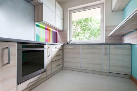 stainless steel kitchen: Colorful, bright, modern kitchen with big window Stock Photo