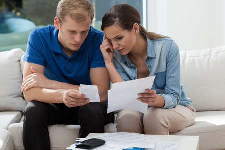 budget crisis: View of analyzing family budget at home Stock Photo