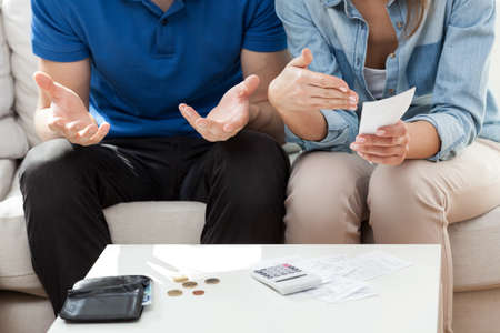 finance problems: Couple having not enough money for bills Stock Photo