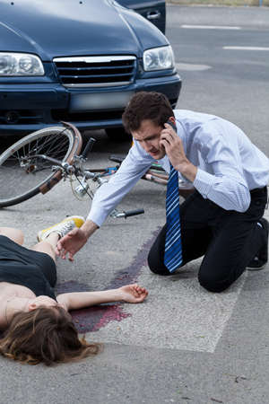 road accident: Man calling the emergency service after car accident Stock Photo