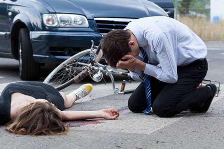 Dead woman on the pedestrian crossing, horizontal