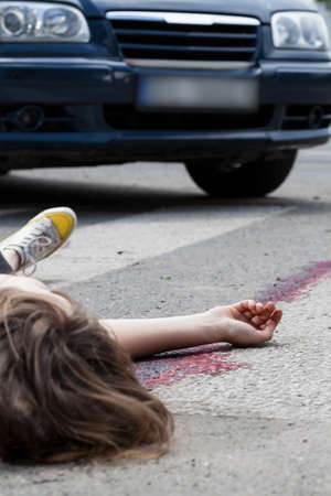 dissociation: Female pedestrian after accident on the street