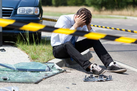 Horizontal view of man after car accident Stock Photo