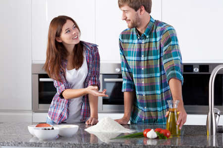 Horizontal view of couple before making pizza photo
