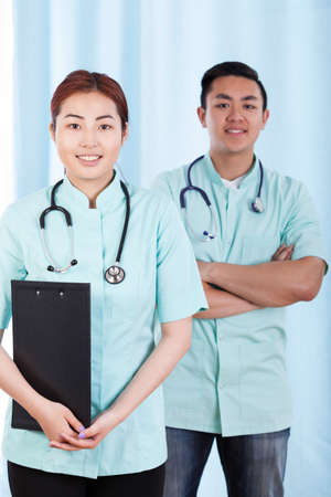 Vertical view of mongolian and asian doctors