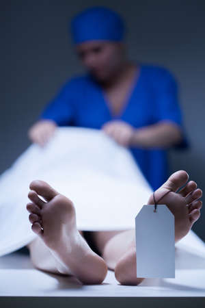 cadaver: Nurse during working in the mortuary, vertical
