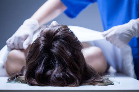 mortuary: View of nurse covering the dead body