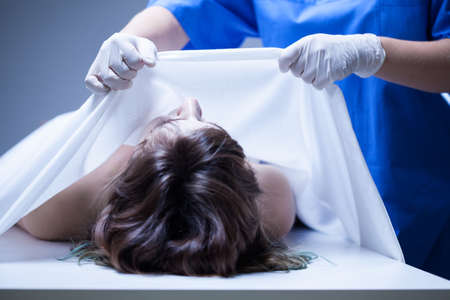 autopsy: Covering female body in the mortuary, horizontal Stock Photo