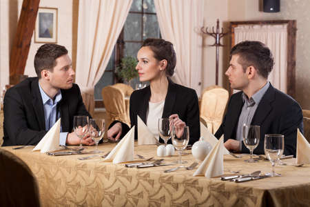 business dinner: Horizontal view of business meeting in restaurant Stock Photo