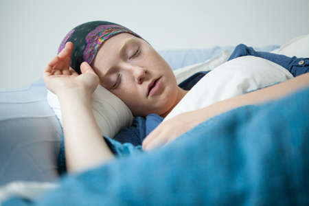 Close-up of young woman having tumor sleeping