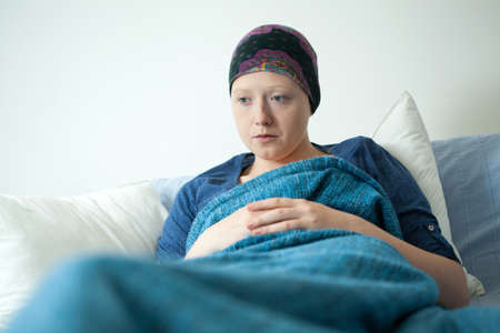 woeful: Close-up of young woman having carcinoma worrying