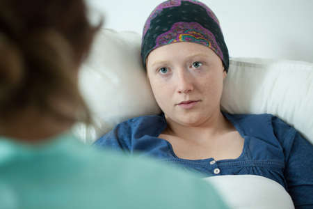 Close-up of ill with leukemia girl wearing headscarf Stock Photo