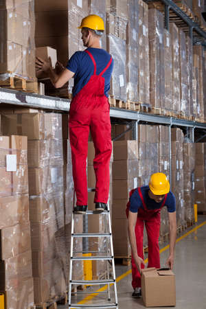 safety box: View of working workers in a factory Stock Photo