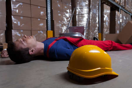 Man on the floor in a factory photo