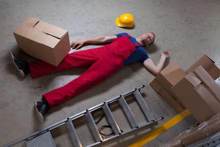 Man after accident on a ladder, horizontal