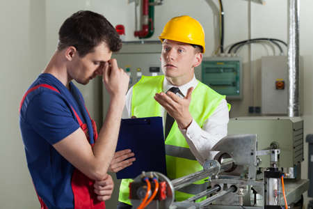 storekeeper: Worker made a mistake in a factory, horizontal Stock Photo