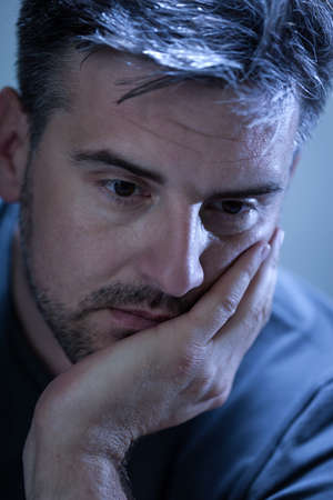 Portrait of sad, deppresed young man photo