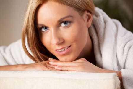 Beauty young woman relaxing in wellness center photo
