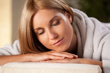 Close-up of beauty woman lying in spa room photo