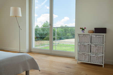 Horizontal view of window in spacious bedroom Stock Photo