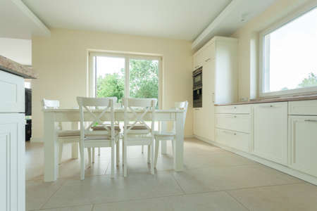 designed: White table in a modern kitchen, horizontal