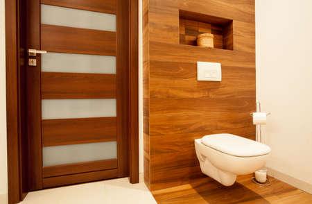 bathroom equipment: Horizontal view of toilet in wooden bathroom Stock Photo