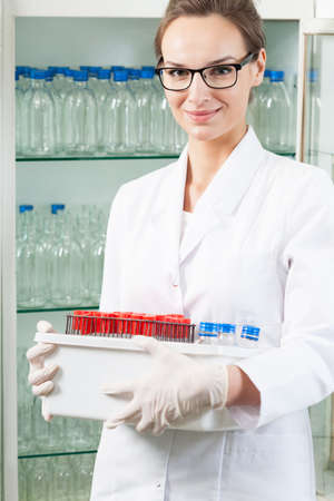 lab equipment: Lab assistant holding box with chemical equipment Stock Photo