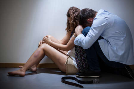 brawl: Ashamed torturer apologize his wife after brawl Stock Photo