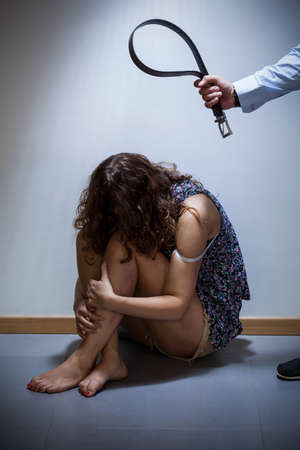 domestic: Wife being a victim of violence and her torturer Stock Photo