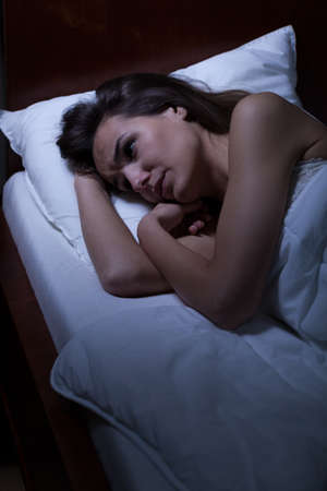 charming woman: Woman lying awake in bed at night
