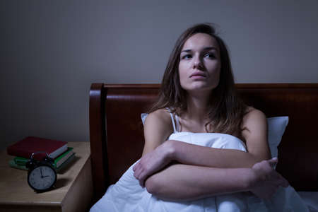 Pensive woman stying sleepless in bed at night