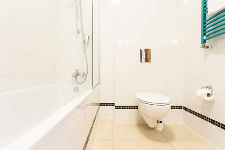 View of bathroom with toilet and bathtub photo