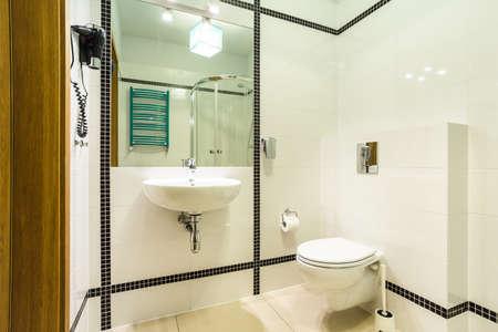bathroom equipment: Horizontal view of black and white bathroom