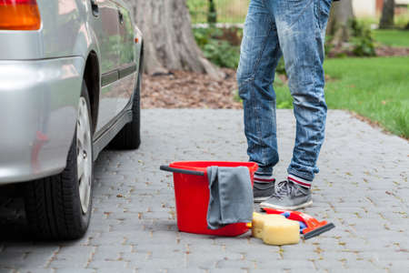 wash: Red bucket, sponge and remain tools for cleaning the car