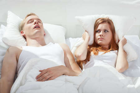 Beauty woman being angry on snoring boyfriend
