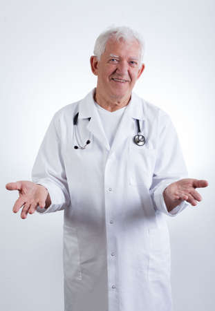 practiced: Vertical view of smiling experienced male doctor Stock Photo