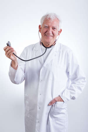 practiced: Image of practiced senior doctor with stethoscope Stock Photo