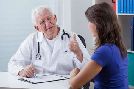 general practitioner: Image of general practitioner showing thumb up Stock Photo