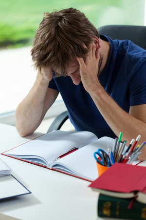 tiredness: Young student depressed and tired before hard examination