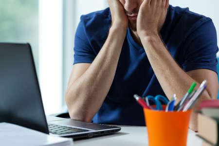 examination stress: Young sad student preparing hardly to exam Stock Photo
